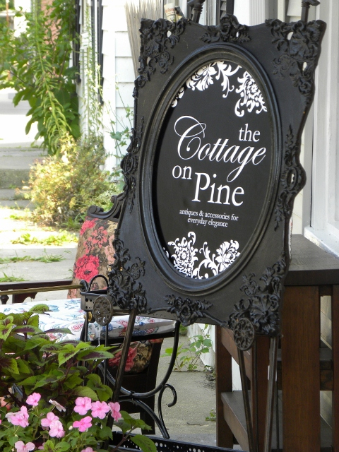 Cottage sign on front porch 480x640