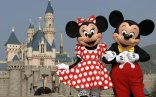 HONG KONG - SEPTEMBER 1: (EDITORIAL USE ONLY) In this handout photo provided by Disney, Mickey and Minnie Mouse are seen in front of the Sleeping Beauty Castle at the new Disneyland Park on September 1, 2005 in Hong Kong. The new theme park and vacation resort will officially open September 12. (Photo by Mark Ashman/Disney via Getty Images)