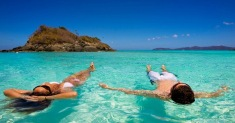 kw-290617-A-couple-swimming-in-the-Caribbean-waters-at-Trunk-Bay-in-US-Virgin-Islands